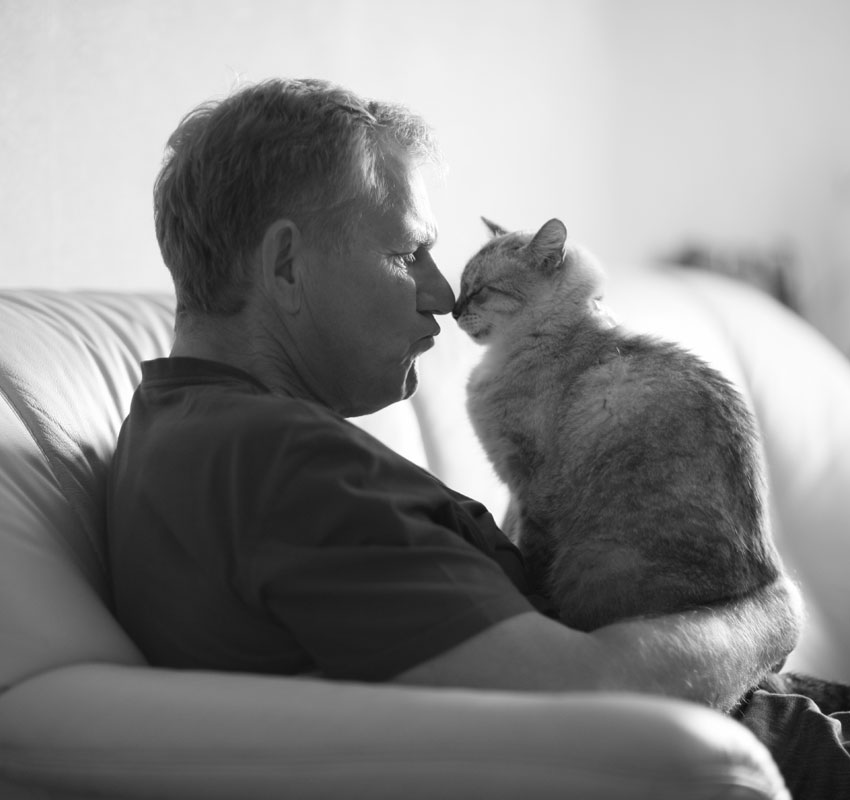 Man with cat on couch